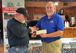 Post Commander Larry Anderson presents a check to Vets Roll Co-Founder Mark Finnegan.